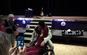 Billy Lindsay, Elvis Presley impersonator, getting photo taken with women in wheel chair at the Borini Theater in Kings Point Sun City Center, FL