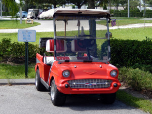1957 Chevy Bel-Air Club Car golf cart next to Kings Point Security Entrance in Sun City Center, FL
