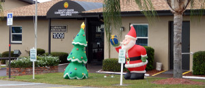 6 feet tall blow up Santa and Christmas Tree at Sun City Center Central Campus