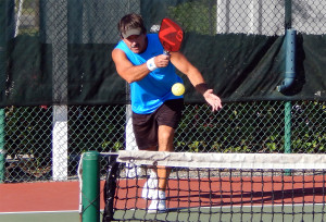 ACTION SHOT Bob Zinsmaster in Mens Doubles PickleballTournament 50 + Tampa Bay Senior Games 2013, Sun City Center, FL [DAY TWO: Saturday, October 26, 2013]