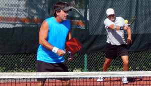 ACTION SHOT by Mike Pascal with Bob Zinsmaste in Men's Doubles Pickleball Tournament 50+ Tampa Bay Senior Games 2013, Sun City Center, FL [DAY TWO: Saturday, October 26, 2013]