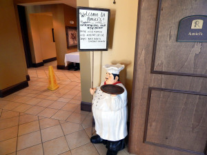 Amicis menu held by 3 foot tall ceramic chef at Club Renaissance in Sun City Center, FL