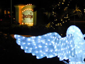 Angel in line with Kings Point entrance sign, Sun City Center