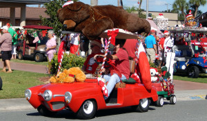 BEAR on roof of STUDEBAKER golf cart leaving Sun City Center Holiday Golf Cart Parade 2013