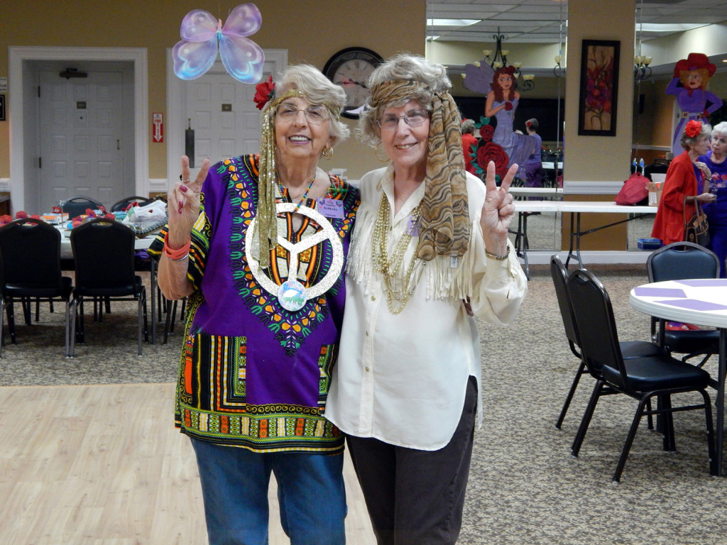 Left to Right: Barbara Nightingale (AKA 'Flutterby Butterfly') and President Elaine Massaro (AKA 'Madam Butterfly') of The Purple Butterflies Club of Sun City Center in the Florida Room.