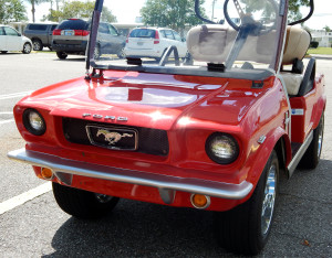 Bright red 1965 Mustang Club Car golf cart in Sun City Center, FL