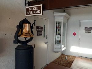 CONDUCTORS BELL by door of Sun CIty Center Model Railroad Club