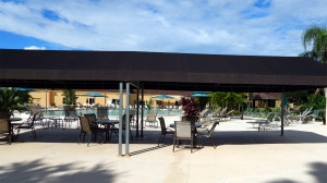Main Clubhouse Pool has big canopies on deck for shade In Kings Point, Sun City Center, FL