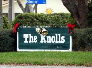 Christmas bow and bells on KNOLLS sign, Kings Point, Sun City Center, Florida