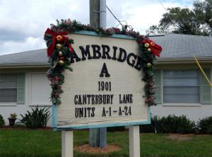 Christmas decor on CAMBRIDGE Association sign in Sun City Center, Florida