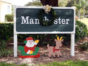 Christmas reef with Santa Clause on Manchester associations sign in Sun City Center, Florida