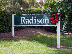Christmas reef with red flowers on Radison entrance sign in Sun City Center, Florida