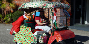 Christmas wrapping paper covers entire golf cart in Sun City Center Holiday Golf Cart Parade 2013
