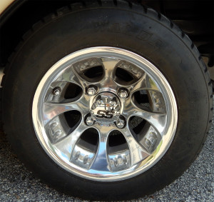 Chrome SS wheels with Wanda tires on Red Ford Truck Club Car golf cart in Sun City Center, Fl