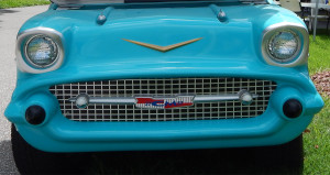 Close up zoom of front grill of Blue 57 Chevy Belair Customized Golf Cart parked at the Communtiy Hall in Sun City Center Fl
