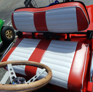 Custom leather red and white seats on 1965 Ford Mustang golf cart at Walgreens in Sun City Center, Florida
