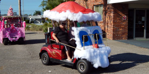 Customized Santa Clause golf cart begins at Sun City Center Holiday Golf Cart Parade 2013