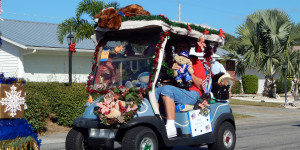 DOG and decorations on golf cart at Sun City Center Holiday Golf Cart Parade 2013
