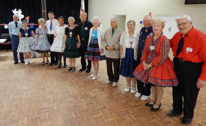 Dance club lined up for photos at Sun City Center Square Dance Club's 45th Anniversary Celebration at Community Hall