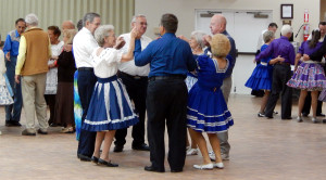 Dancers finishing dance at Sun City Center Square Dance Club's 45th Anniversary Celebration at Community Hall