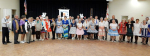 Dancers in group photo at Sun City Center Square Dance Club's 45th Anniversary Celebration at Community Hall