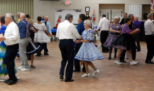 Dancers on wood floor at Sun City Center Square Dance Club's 45th Anniversary Celebration at Community Hall