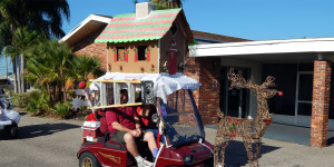 Decorated Christmas House on roof of cart in Sun City Center Holiday Golf Cart Parade 2013