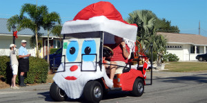 ED BARNS in Santa Clause golf cart in Sun City Center Holiday Golf Cart Parade 2013