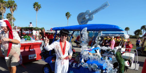 ELVIS PRESLEY with customized guitar golf cart in line for Sun City Center Holiday Golf Cart Parade 2013