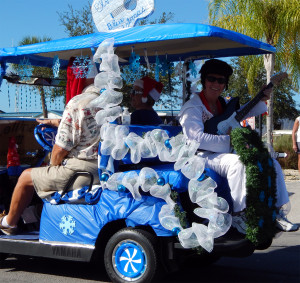 ELVIS riding in back of VERSAILLES III golf cart in Sun City Center Holiday Golf Cart Parade 2013