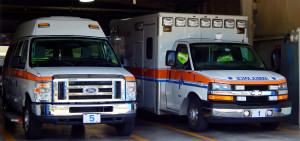 Emergency Ambulance and Van in Sun City Center Emergency Squad garage