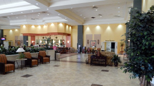 Looking at the Borine doors in the background while standing in the main lobby at the Kings Point Main Clubhouse, Sun City Center