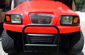 Front grille of Red Ford Truck Club Car golf cart in Sun City Center, Fl