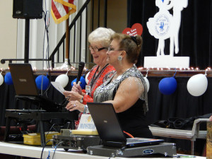 Geri Kilgallon and Patricia Hagen announcing ticket winners at Sun City Center Square Dance Club's 45th Anniversary Celebration at Community Hall