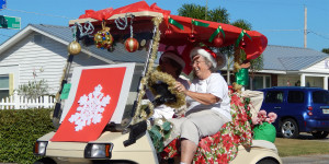 Golf cart 128 with giant snowflake in Sun City Center Holiday Golf Cart Parade 2013