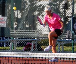 Hitting ball on one leg in Womens Doubles Pickleball Tournament Tampa Bay Senior Games 2013 Sun City Center