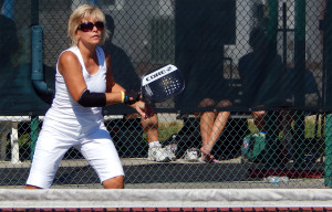 Hitting ball over net in Womens Pickleball Tournament Tampa Bay Senior Games 2013 Sun City Center FL
