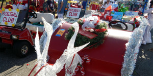 Holiday decorated golf carts at golf cart parade in Florida