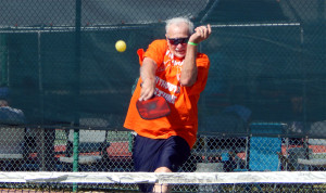Hitting fast ball in Mixed Doubles Pickleball Tournament 2013 Tampa Bay Senior Games, Sun City Center [DAY THREE: Sunday, October 27, 2013]