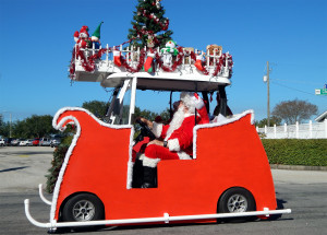 INDIVIDUAL Category - 4th Joe and Rita Bealey (#133) in sleigh golf cart dressed like Santa Clause in Individual category at Sun City Center Golf Cart Parade 2013