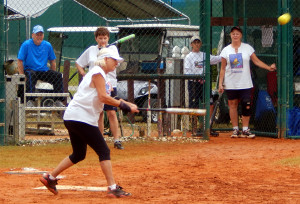 Southpaw batter hits ball in LADIES ONE PITCH Softball Tournament on Don Senk field, November 2 2013, Sun City Center, Florida