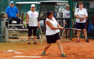 Woman hitting ball in LADIES ONE PITCH Softball Tournament on Don Senk field, November 2 2013, Sun City Center, Florida
