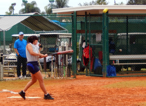 Southpaw batter hits ball hard in LADIES ONE PITCH Softball Tournament on Don Senk field, November 2 2013, Sun City Center, Florida