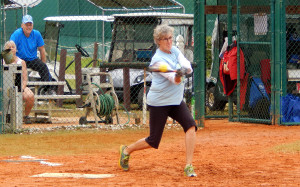 Women hitting ball in LADIES ONE PITCH Softball Tournament on Don Senk Field organized by Vintage Babes of Sun City Center FL 2013