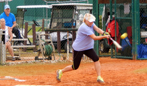 Female hitting ball in LADIES ONE PITCH Softball Tournament on Don Senk field, November 2 2013, Sun City Center, Florida