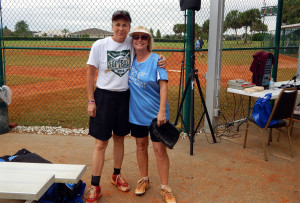 Vintage Babe has picture taken with Clearwater team at the LADIES ONE PITCH 2013 Softball Tournament on November 2, on Don Senk Field in Sun City Center
