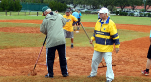Cleaning field at LADIES ONE PITCH Softball Tournament on Don Senk field, November 2 2013, Sun City Center, Florida