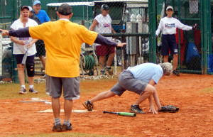 Umpire signals safe in LADIES ONE PITCH Softball Tournament on Don Senk field, November 2 2013, Sun City Center, Florida