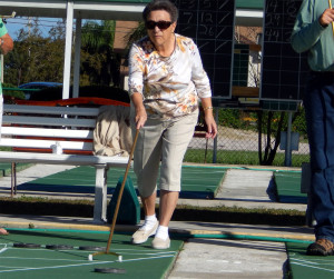 Lady playing shuffleboard in Kings Point, Sun City Center, FL