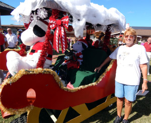 INDIVIDUAL Category - 2nd John and Laura O'Conner with customized Sleigh golf cart at Sun City Center Golf Cart Parade 2013